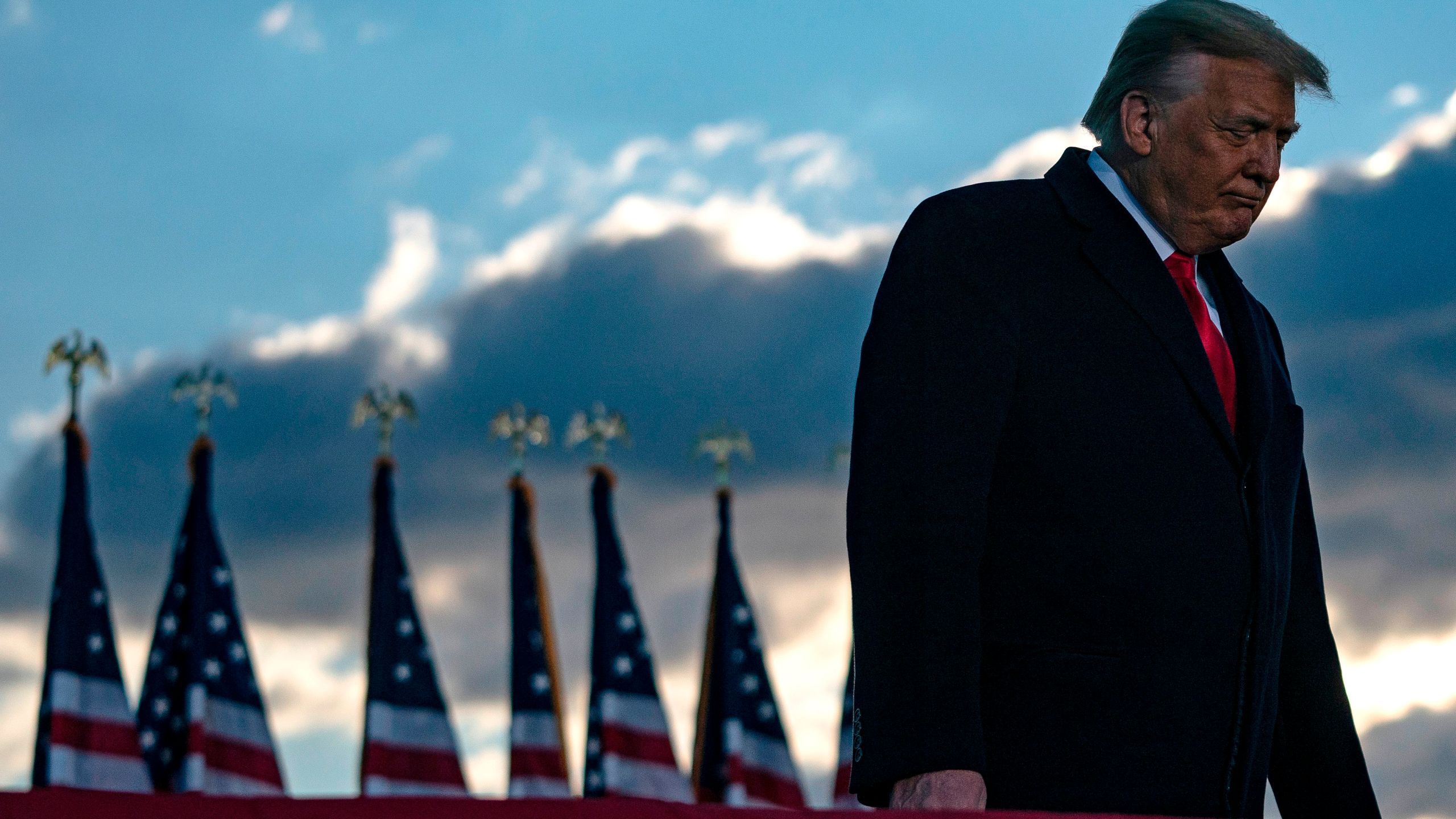 Outgoing US President Donald Trump addresses guests at Joint Base Andrews in Maryland on January 20, 2021. (ALEX EDELMAN/AFP via Getty Images)