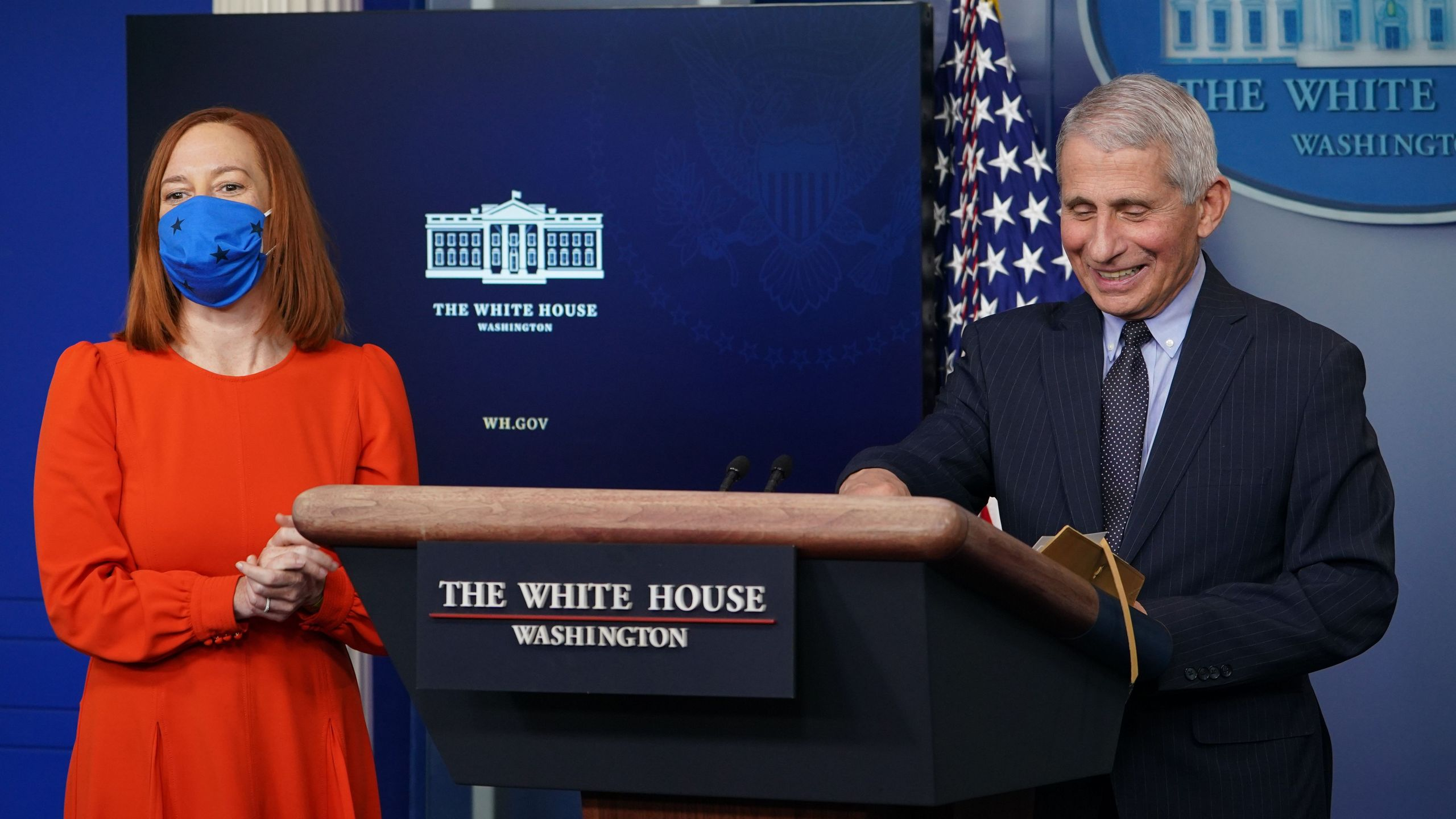 National Institute of Allergy and Infectious Diseases Anthony Fauci smiles as White House Press Secretary Jen Psaki (L) speaks to reporters during the daily briefing in the Brady Briefing Room of the White House in Washington, DC on January 21, 2021. (MANDEL NGAN/AFP via Getty Images)