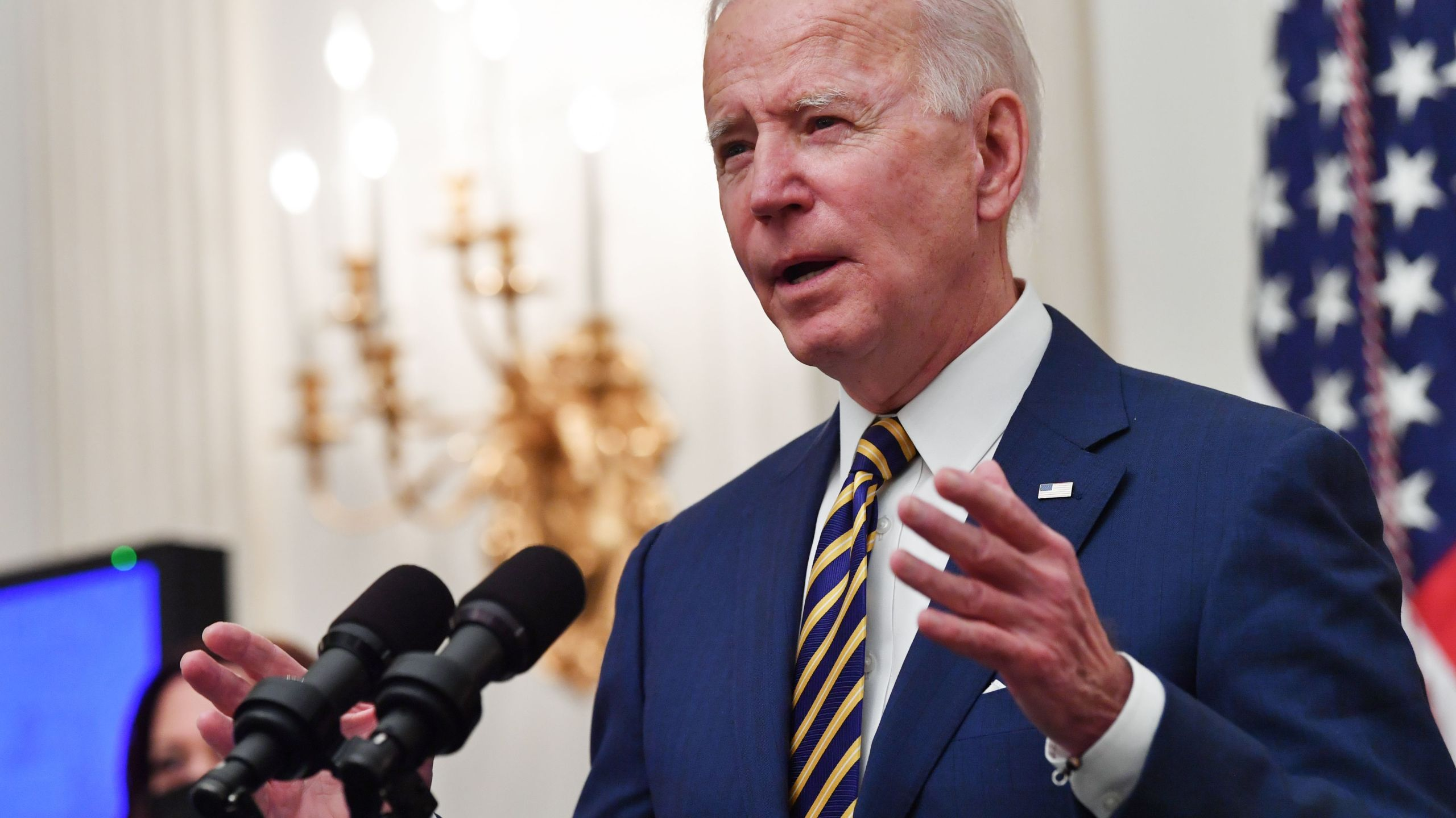 US President Joe Biden speaks about the Covid-19 response before signing executive orders for economic relief to Covid-hit families and businesses in the State Dining Room of the White House in Washington, DC, on January 22, 2021. (Nicholas Kamm/AFP via Getty Images)