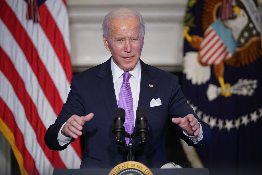 US President Joe Biden speaks on COVID-19 response in the State Dining Room of the White House in Washington, DC on Jan. 26, 2021.(MANDEL NGAN/AFP via Getty Images)