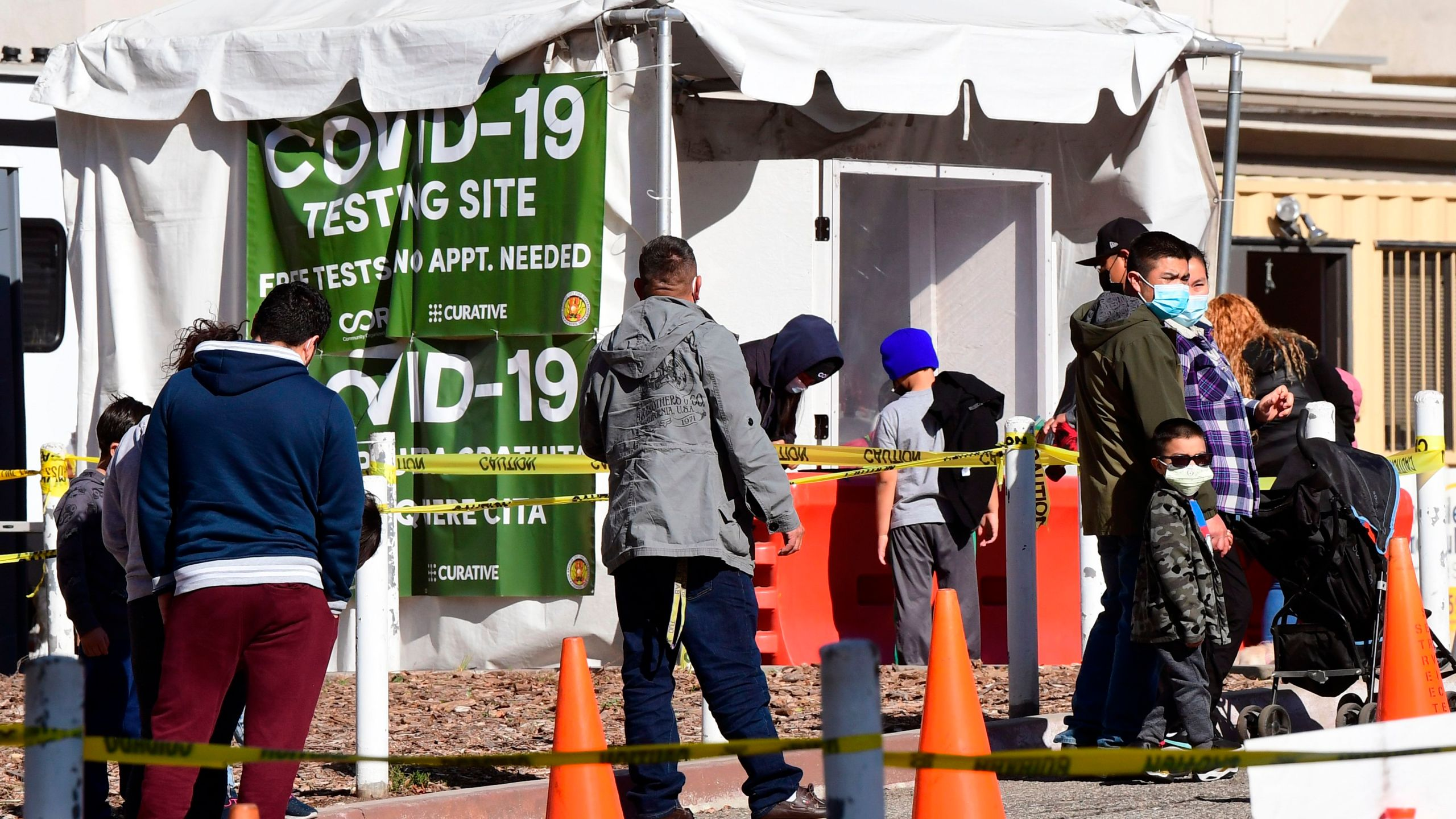 People arrive at a walk-up COVID-19 testing site at Lincoln Park in Los Angeles on Jan. 28, 2021. (Frederic J. Brown / AFP / Getty Images)
