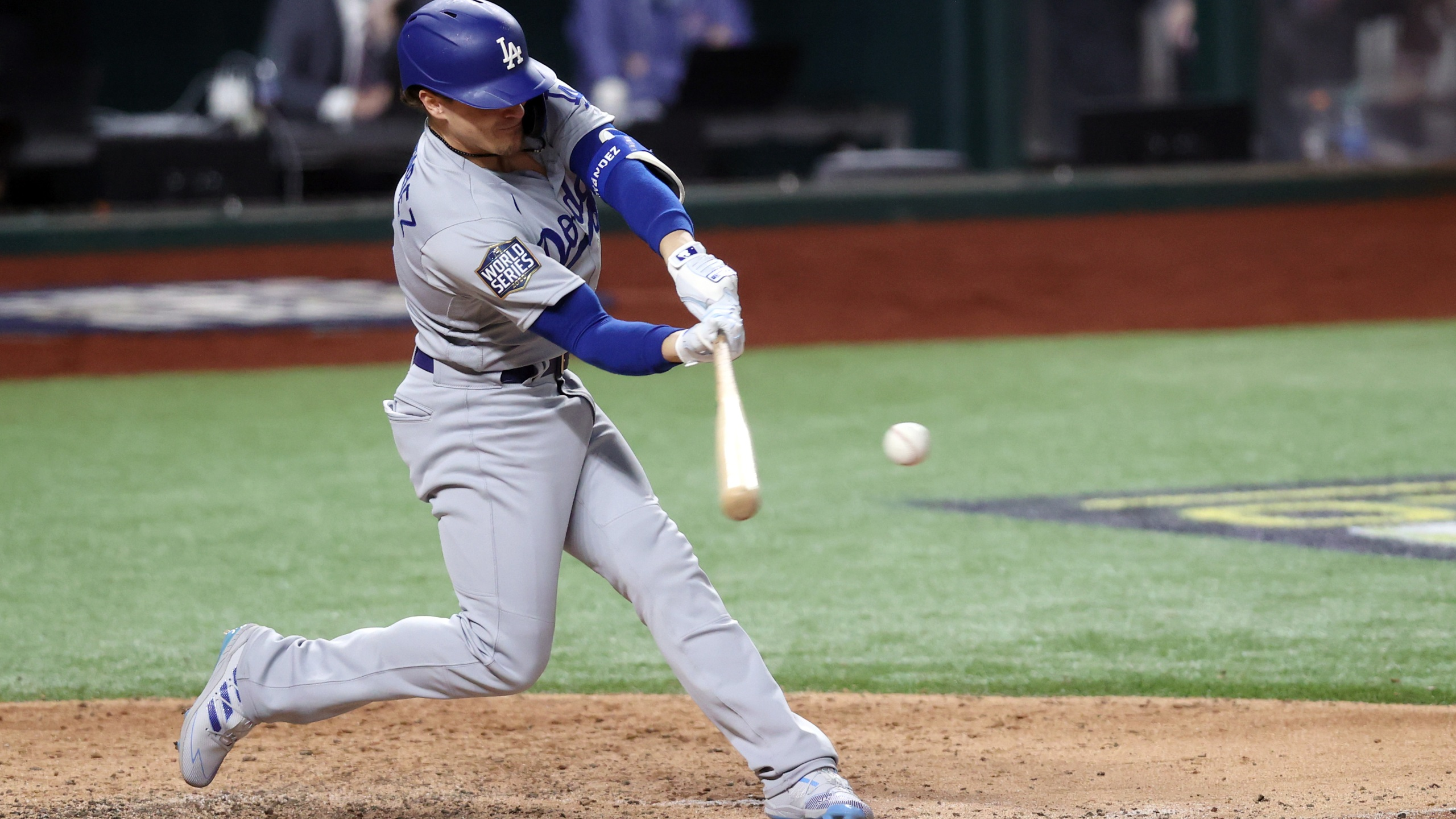 Enrique Hernandez #14 of the Los Angeles Dodgers hits an RBI double against the Tampa Bay Rays during the sixth inning in Game Four of the 2020 MLB World Series at Globe Life Field on October 24, 2020 in Arlington, Texas. (Tom Pennington/Getty Images)