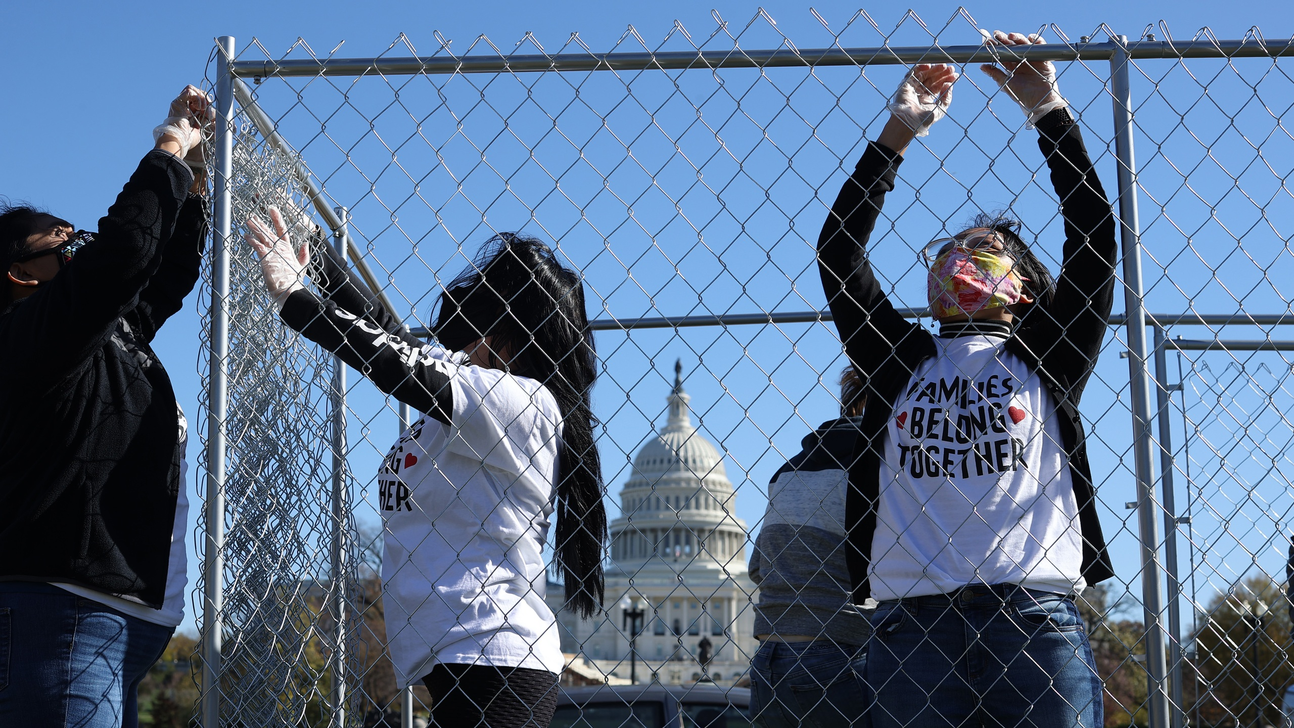 "Volunteers from immigrant advocacy group Families Belong Together build a chainlink cage to fill with about 600 teddy bears ""representing the children still separated as a result of U.S. immigration policies"" on the National Mall Nov. 16, 2020 in Washington, D.C. (Chip Somodevilla/Getty Images)"