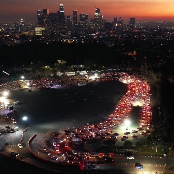 In an aerial view from a drone, cars are seen lined up at Dodger Stadium for coronavirus testing as dusk falls over downtown Los Angeles on Dec. 2, 2020. (Mario Tama/Getty Images)