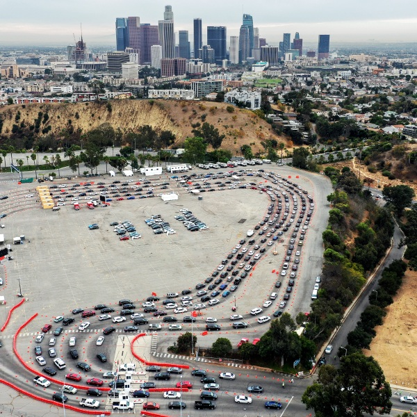 In an aerial view from a drone, vehicles line up to enter a COVID-19 testing site at Dodger Stadium on the first day of new stay-at-home orders on December 7, 2020 in Los Angeles, California. (Mario Tama/Getty Images)
