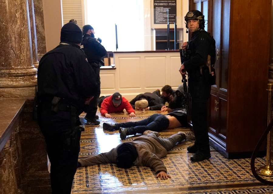 U.S. Capitol Police stand detain protesters outside of the House Chamber during a joint session of Congress on January 06, 2021 in Washington, DC. (Drew Angerer/Getty Images)