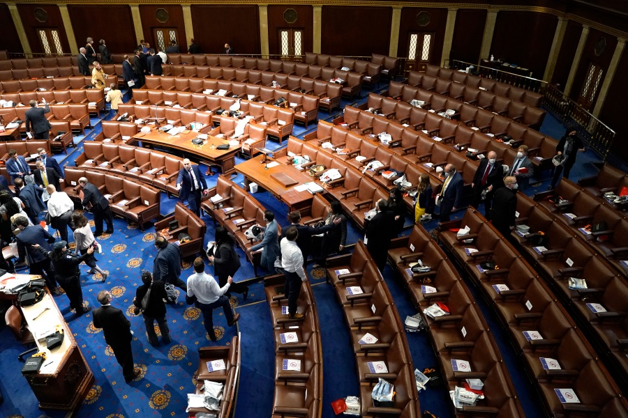 Members of Congress evacuate the House Chamber as protesters attempt to enter during a joint session of Congress on January 06, 2021 in Washington, DC. (Drew Angerer/Getty Images)