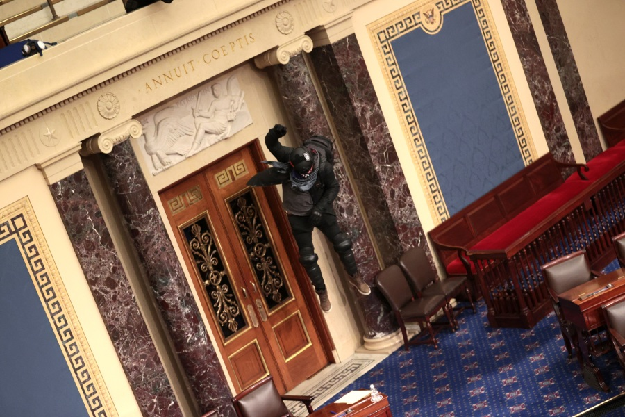Protesters enter the Senate Chamber on January 06, 2021 in Washington, DC. (Win McNamee/Getty Images)