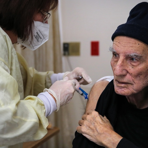 A nurse administers a dose of the Moderna COVID-19 vaccine to a resident at the Ararat Nursing Facility in the Mission Hills neighborhood of Los Angeles on Jan. 8, 2021 in Los Angeles.(Mario Tama/Getty Images)