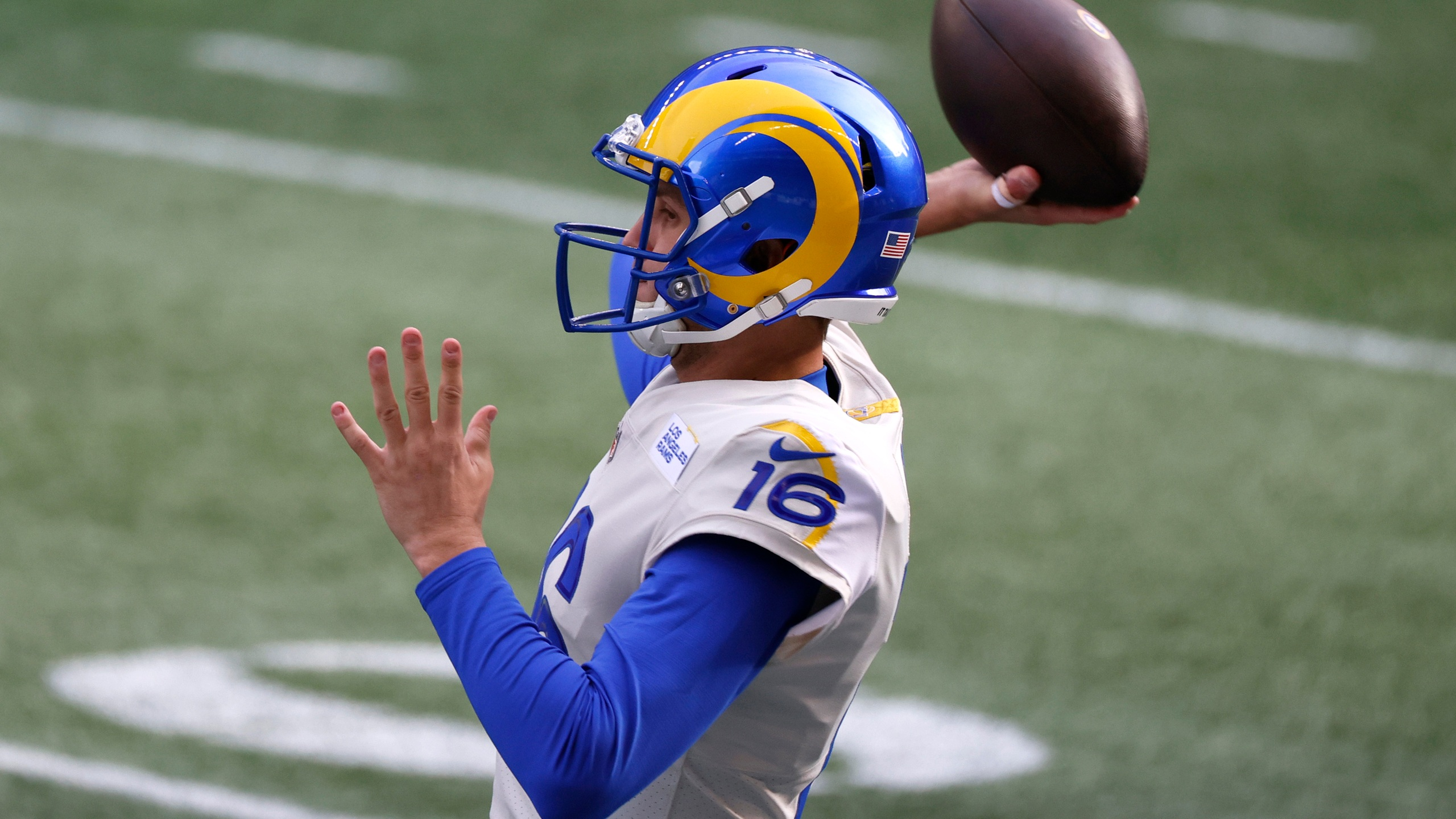 Quarterback Jared Goff, No. 16 of the Los Angeles Rams, warms up prior to the NFC Wild Card Playoff game against the Seattle Seahawks at Lumen Field on Jan. 9, 2021 in Seattle, Washington. (Steph Chambers/Getty Images)