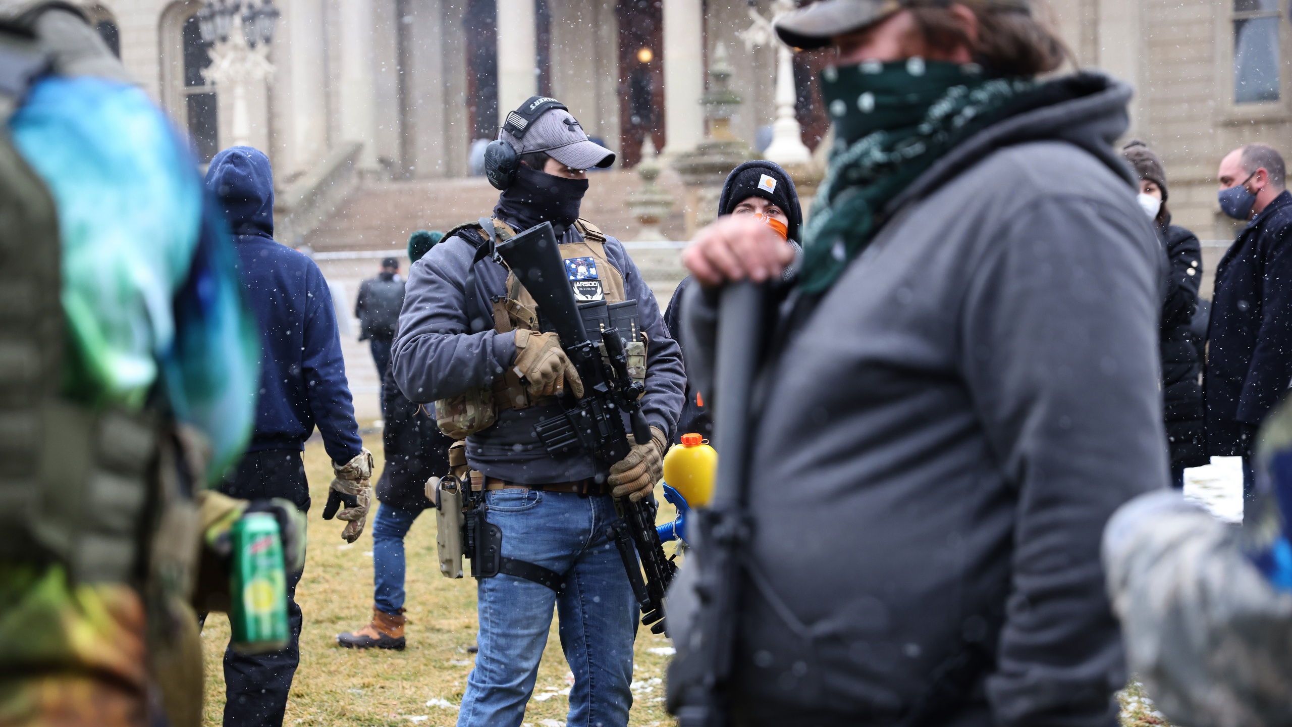 Armed demonstrators protest outside of the Michigan state capital building on Jan. 17, 2021 in Lansing, Michigan. (Scott Olson/Getty Images)