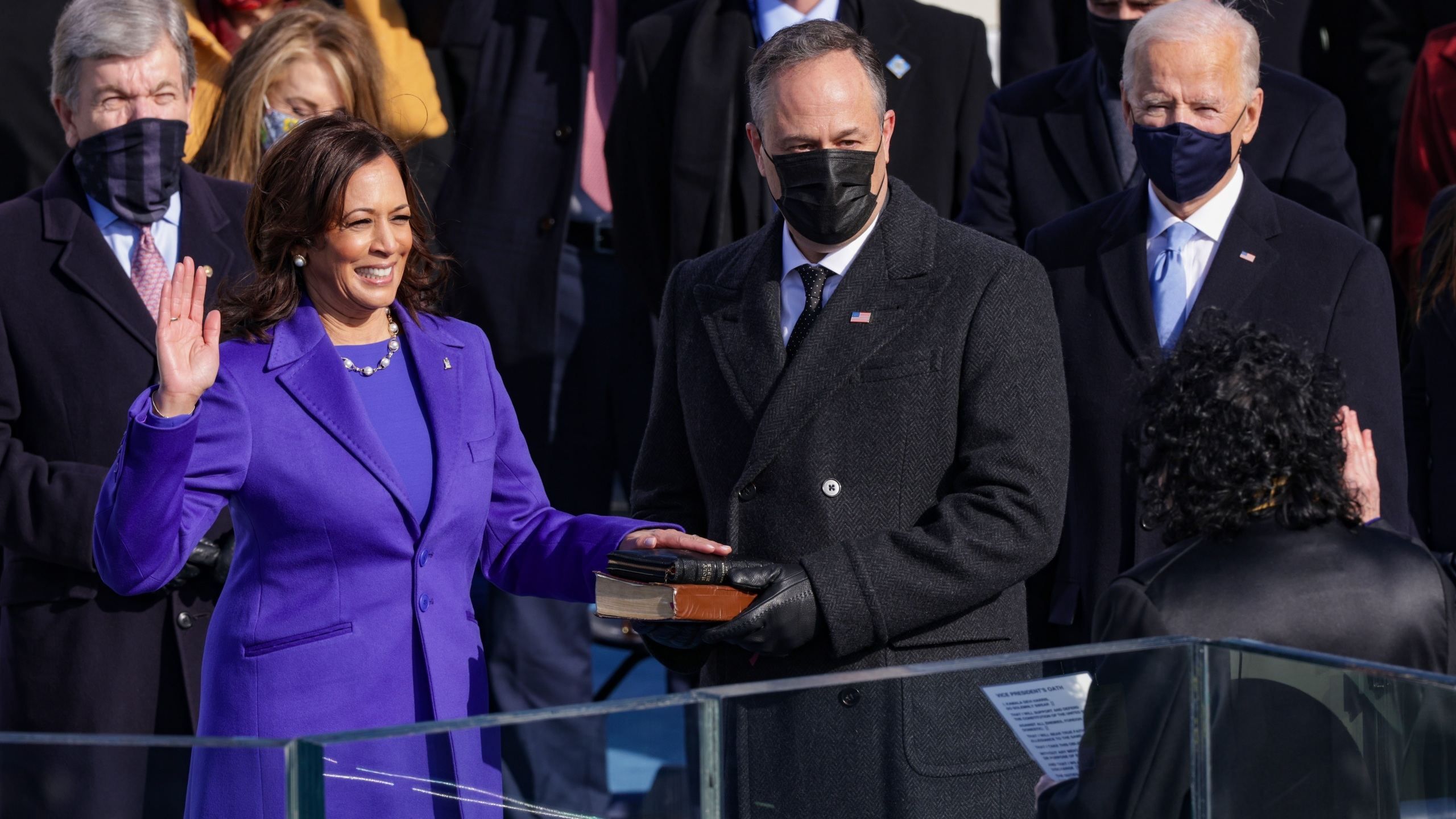 Kamala Harris is sworn as U.S. Vice President by U.S. Supreme Court Associate Justice Sonia Sotomayor as her husband Doug Emhoff looks on at the inauguration of U.S. President-elect Joe Biden on the West Front of the U.S. Capitol on January 20, 2021 in Washington, DC. During today's inauguration ceremony Joe Biden becomes the 46th president of the United States. (Photo by Alex Wong/Getty Images)
