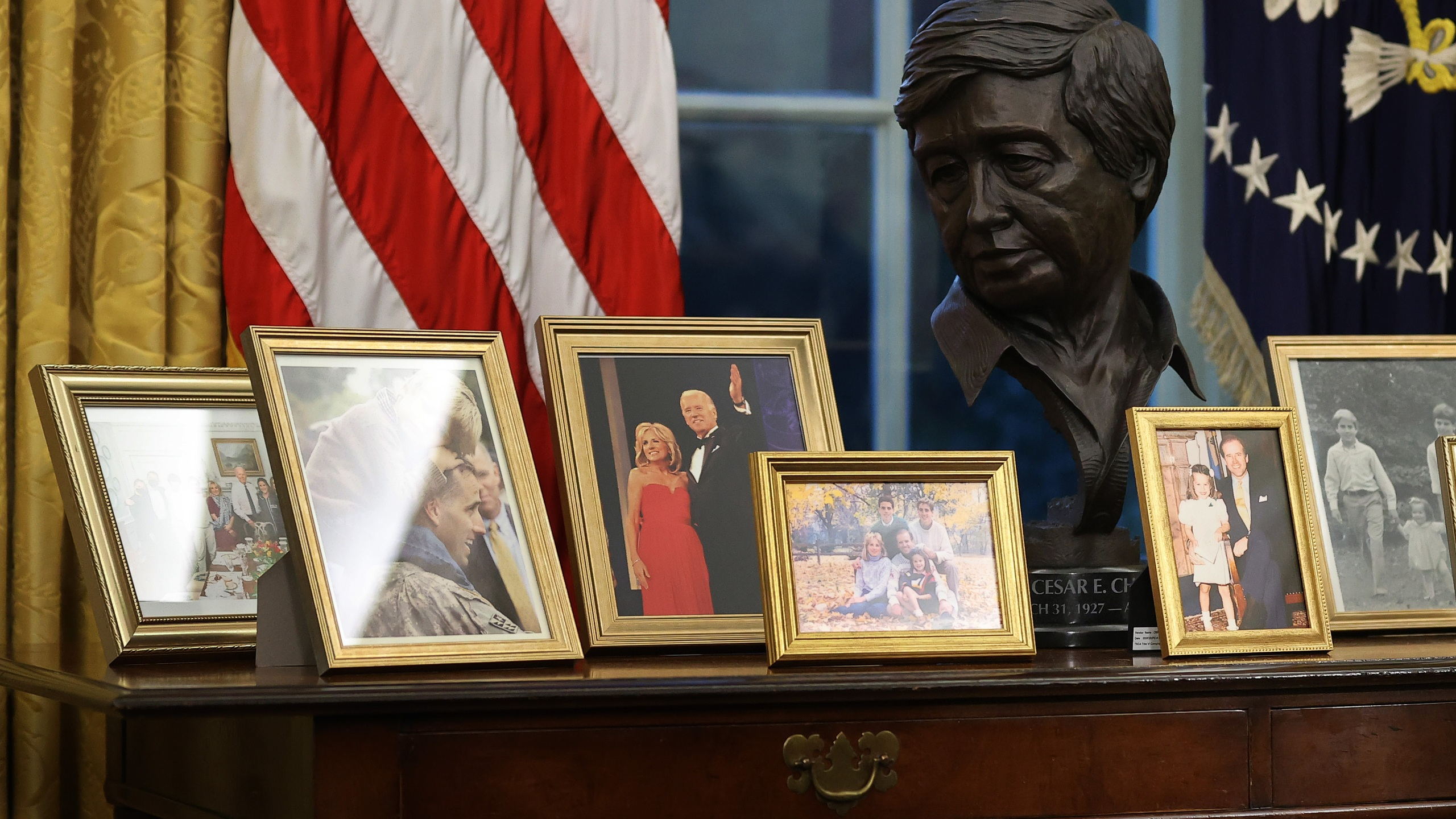 A bust of Cesar Chavez is displayed as President Joe Biden prepares to sign a series of executive orders at the Resolute Desk in the Oval Office just hours after his inauguration on Jan. 20, 2021. (Chip Somodevilla / Getty Images)
