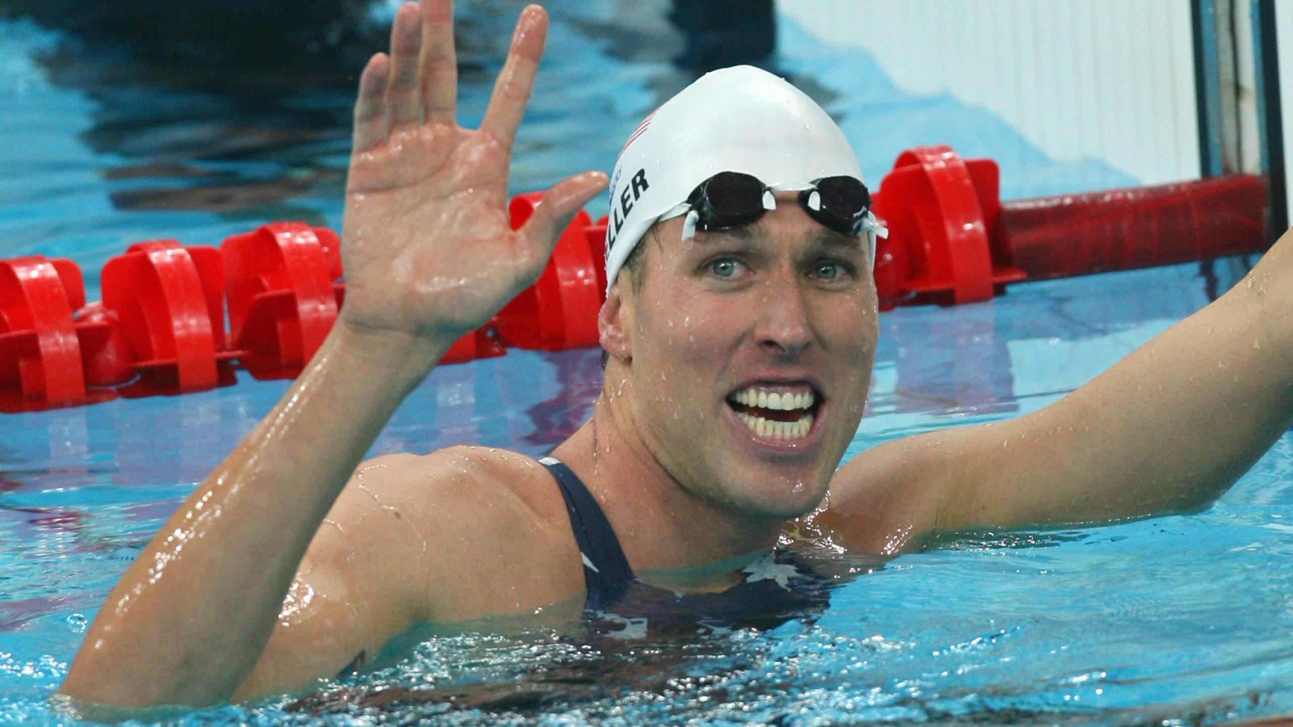 Swimmer Klete Keller smiles after winning the men's 4 x 200m freestyle relay swimming heat in the 2008 Beijing Olympic Games on Aug. 12, 2008. (Greg Wood / AFP / Getty Images)