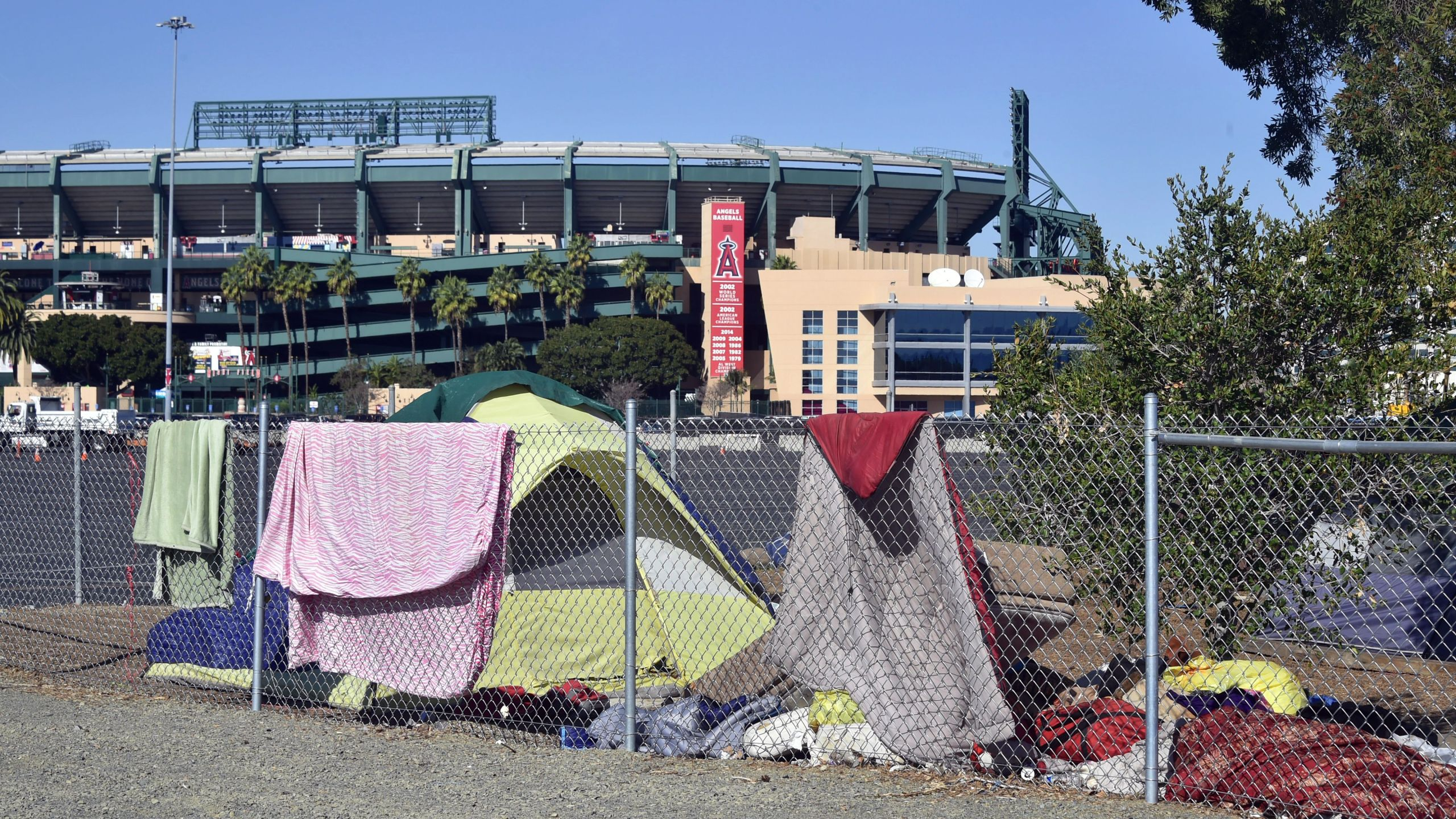 Blankets and tents are seen at a homeless encampment along the Santa Ana river bed near Angel Stadium in Anaheim, California on Jan. 23, 2018.(FREDERIC J. BROWN/AFP via Getty Images)