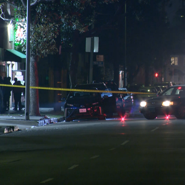 Authorities respond to investigate a triple shooting in the Green Meadows neighborhood of South Los Angeles on Jan. 12, 2021. (KTLA)