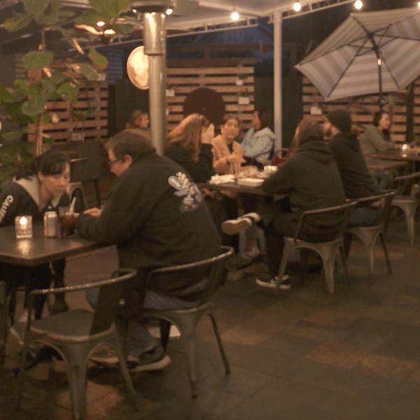 People dine on the patio of Restauration in Long Beach on Jan. 24, 2021. (KTLA)