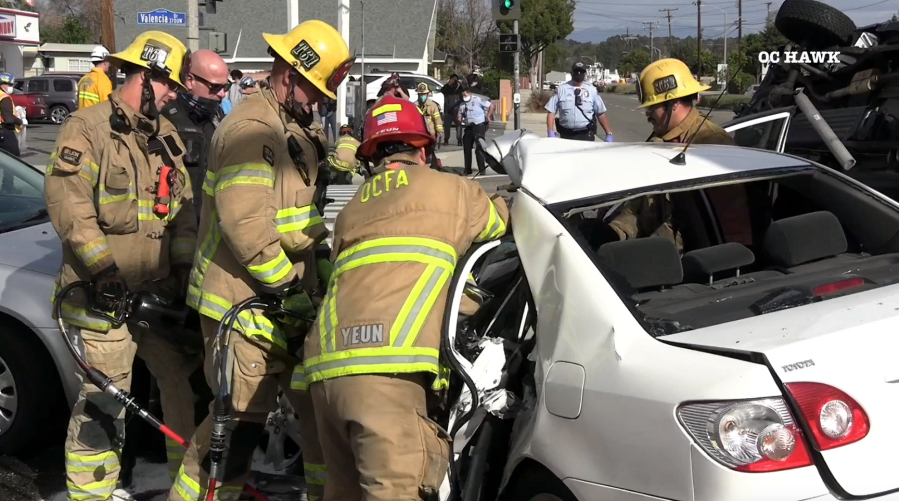 Firefighters work to extricate victims in a Fullerton crash on Jan. 27, 2021. (OC Hawk)