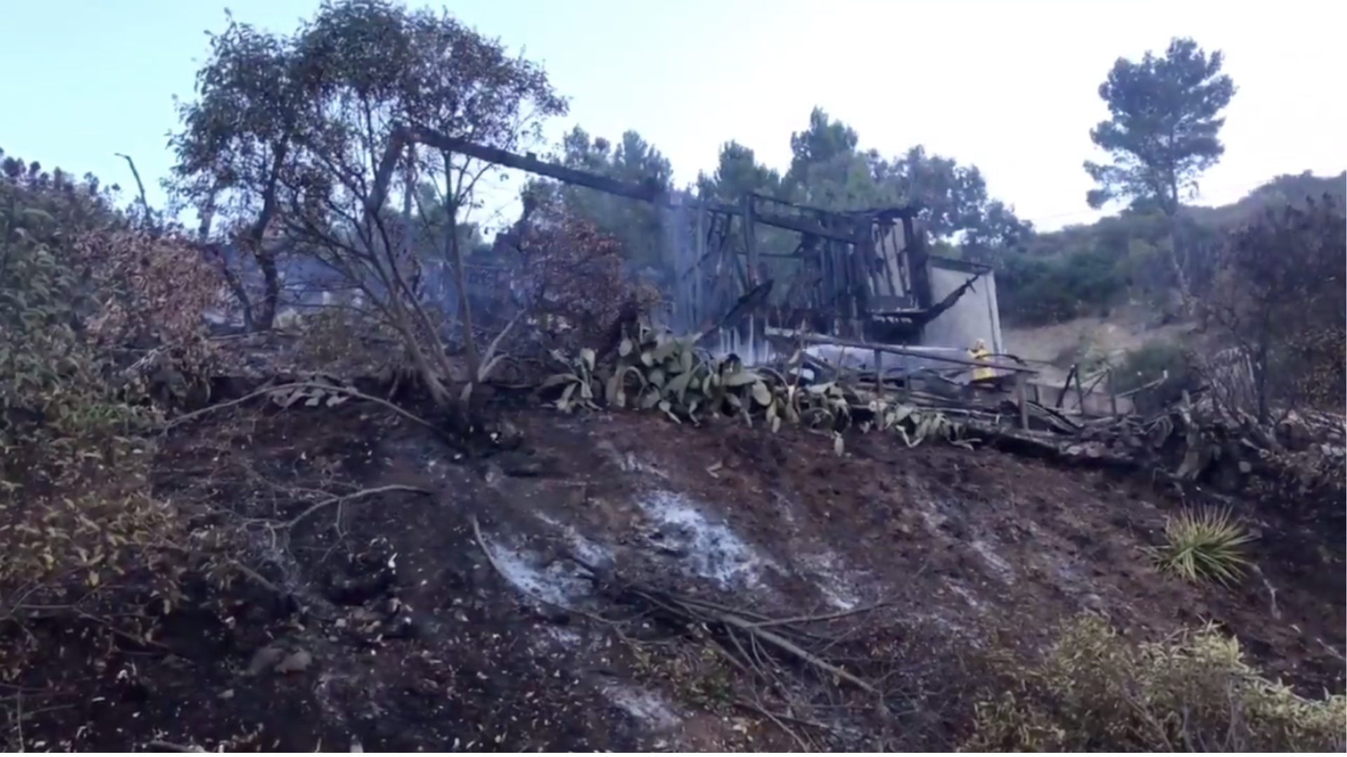 A screenshot from a video tweeted by the L.A. County Fire Department shows the aftermath of a house fire that spread to 4 acres of brush in Malibu on Jan. 17, 2021.