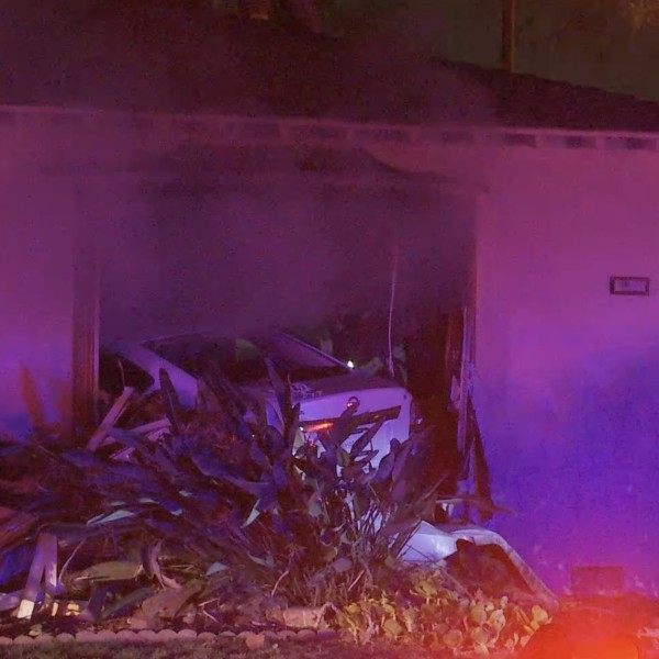 A pursuit ended with a vehicle crashing into a home in Bell on Jan. 19, 2021. (LLN)