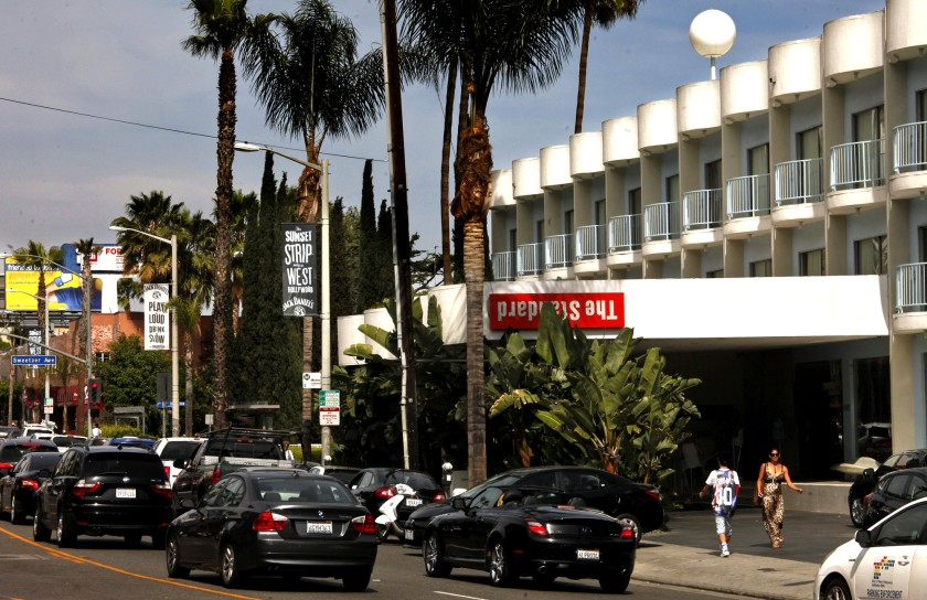 Pedestrians and cars pass the Standard hotel on Sunset Boulevard in West Hollywood in 2014. (Genaro Molina / Los Angeles Times)