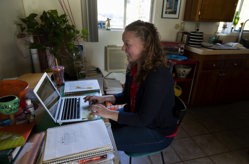 Los Angeles Unified School teacher Casey Jagusch teaches her students remotely from her kitchen table. (Gina Ferazzi / Los Angeles Times)