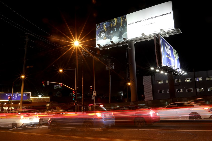 At the intersection of La Cienega Boulevard and Holloway Drive in West Hollywood, a billboard depicts the police killing of George Floyd. (Luis Sinco / Los Angeles Times)