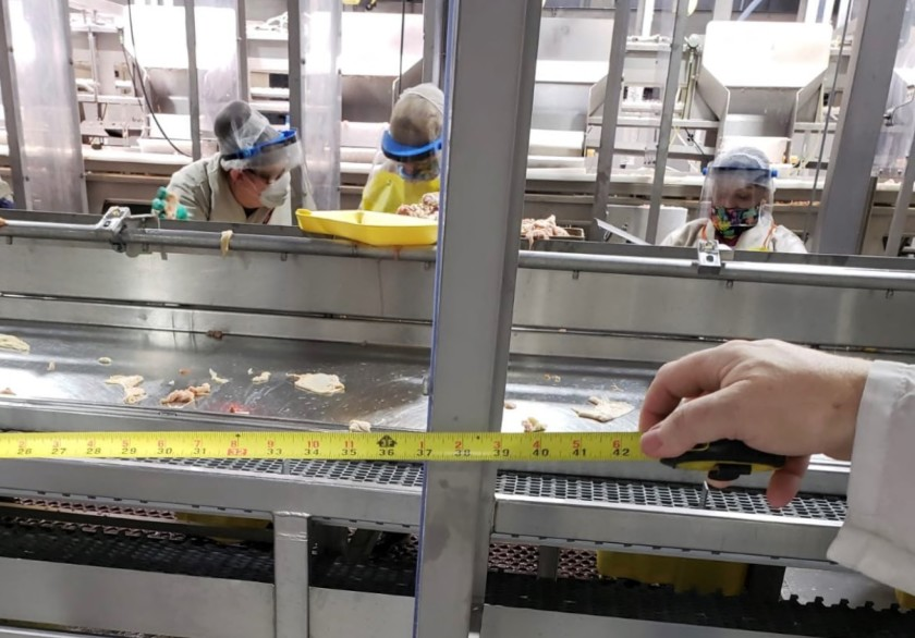 Plexiglass dividers at a meatpacking factory in Livingston, Calif., give workers a little more than three feet of space, according to this photo, which is included in a United Farm Workers lawsuit against Foster Farms. (Oscar Mejia / United Farm Workers)