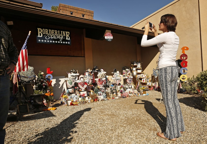Shaina Miller, who knew 10 of the 12 victims of the Borderline Bar and Grill mass shooting in Thousand Oaks, visits the memorial a year after the November 2018 massacre. (Al Seib / Los Angeles Times)