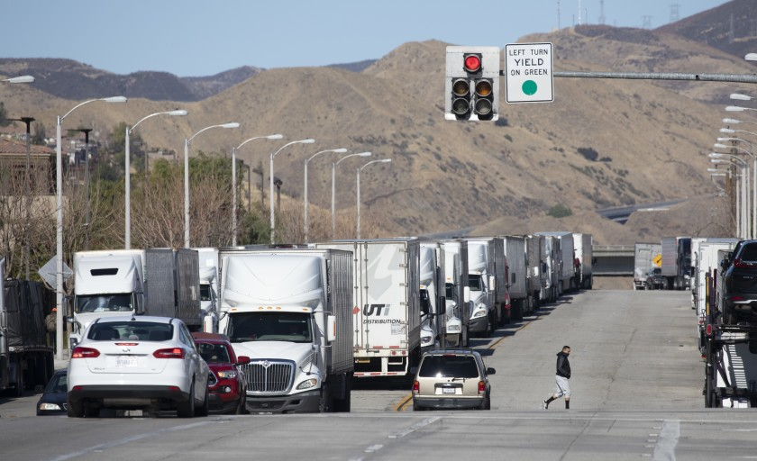 Trucks are parked along Castaic Road in Castaic on Jan. 26, 2021 morning waiting for the 5 Freeway to reopen.(Myung J. Chun / Los Angeles Times)