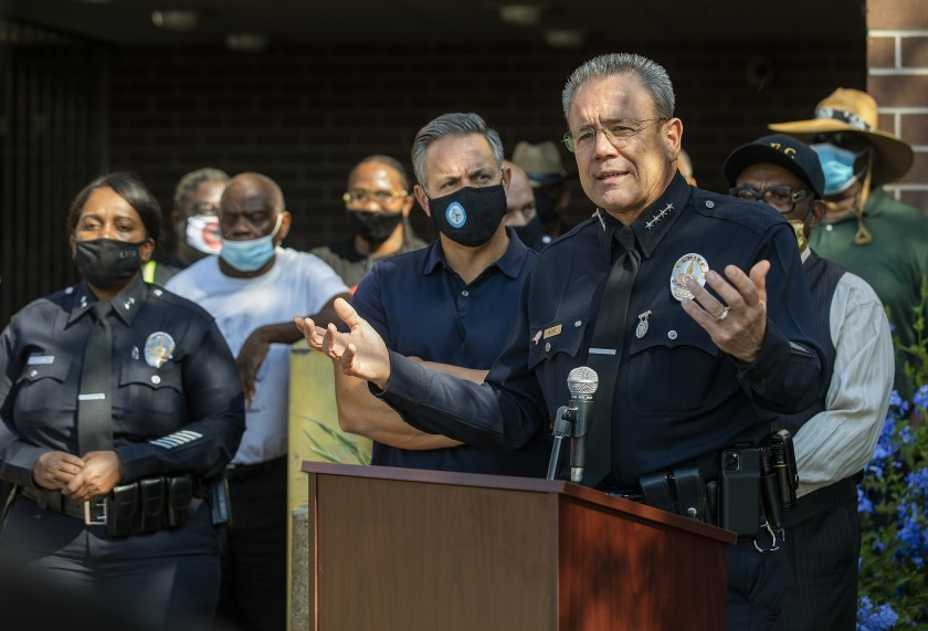 LAPD Police Chief Michel Moore, right, addresses reporters in October outside Southeast Community Police Station to discuss an increase in crime in South Los Angeles. (Mel Melcon / Los Angeles Times)