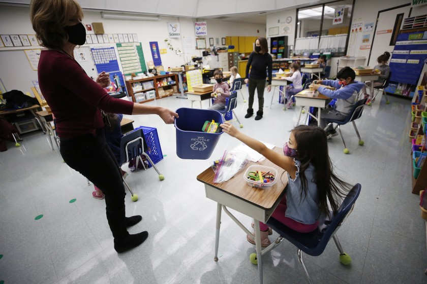 Kindergarten teacher Jennifer Klein collects crayons at Lupin Hill Elementary in Calabasas, which school district officials hope to keep open despite L.A. County's surge in coronavirus infections.(Al Seib / Los Angeles Times)