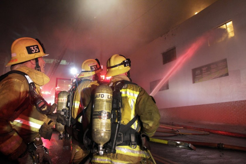 Los Angeles city firefighters are seen battling an Echo Park fire in 2012. (Lawrence K. Ho / Los Angeles Times)