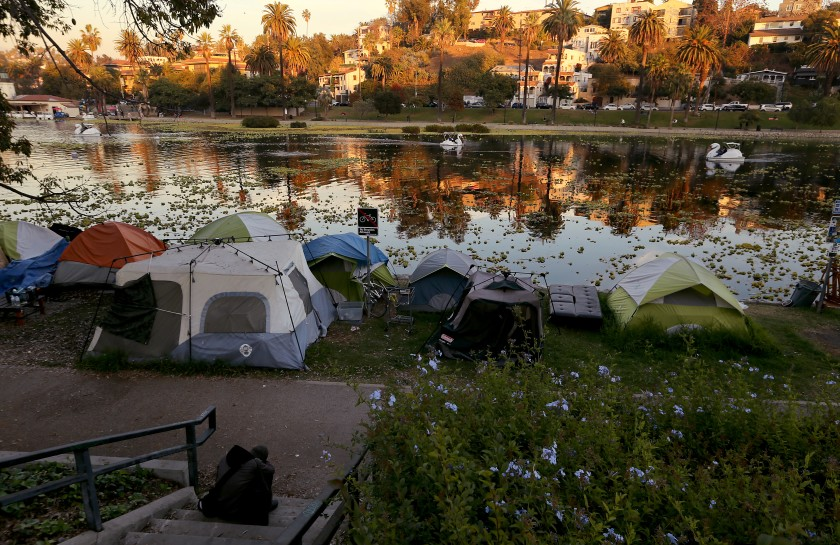 An undated photo shows a homeless encampment on the banks of Echo Park Lake. (Luis Sinco / Los Angeles Times)