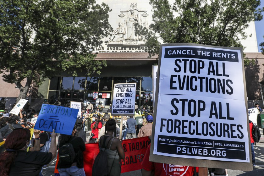 Tenants activists rally at Stanley Mosk Courthouse in downtown Los Angeles to protest eviction orders issued against renters in September 2020. (Irfan Khan / Los Angeles Times)