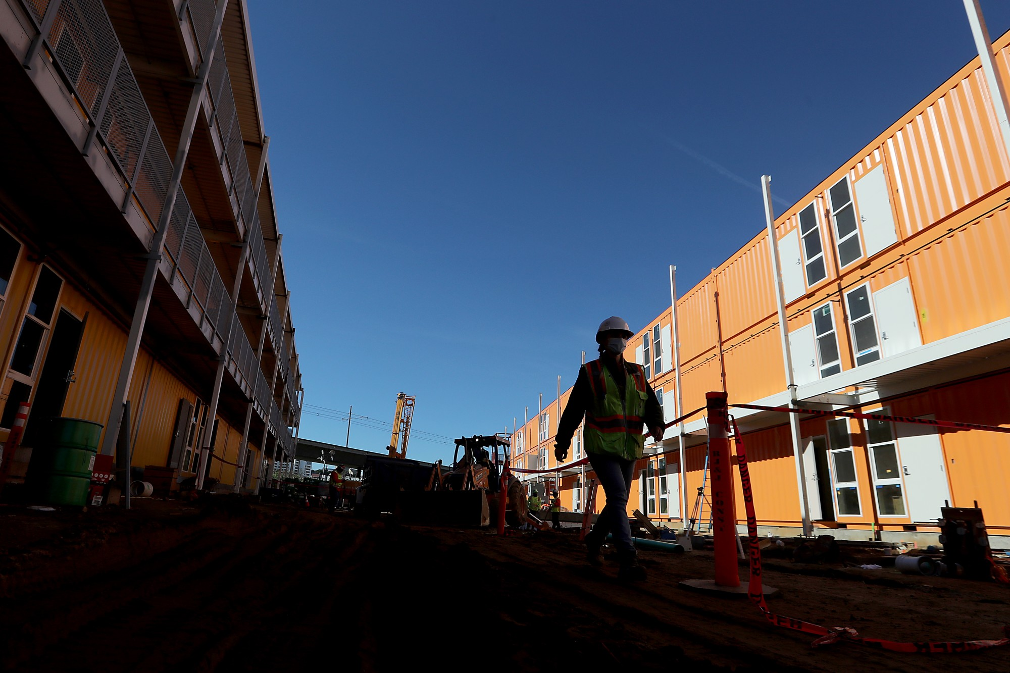 L.A. County contractors are rushing to complete a 232-unit Vignes Street homeless housing development in downtown Los Angeles. Authorities said the project will be a milestone for speed and economy. (Luis Sinco / Los Angeles Times)