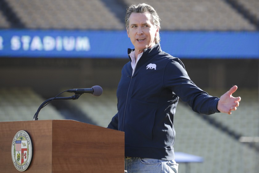 Governor Gavin Newsom holds a press conference at Dodger Stadium on Friday, Jan. 15, 2021. More than 50 Bay Area restaurants are suing Newsom over the outdoor dining ban. (Irfan Khan/Los Angeles Times)