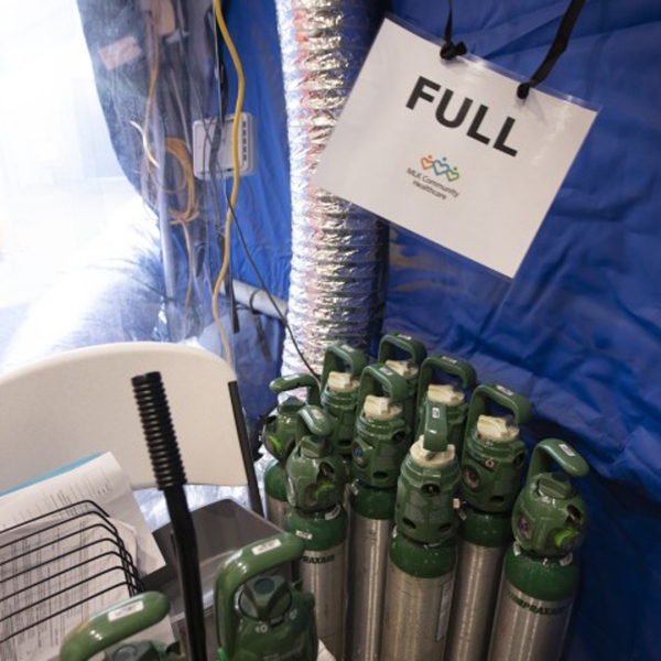 Oxygen tanks are stored in a tent outside Martin Luther King Jr. Community Hospital in this undated photo. Federal engineers will be evaluating the oxygen-delivery systems at six other hospitals in Los Angeles County. (Francine Orr / Los Angeles Times)