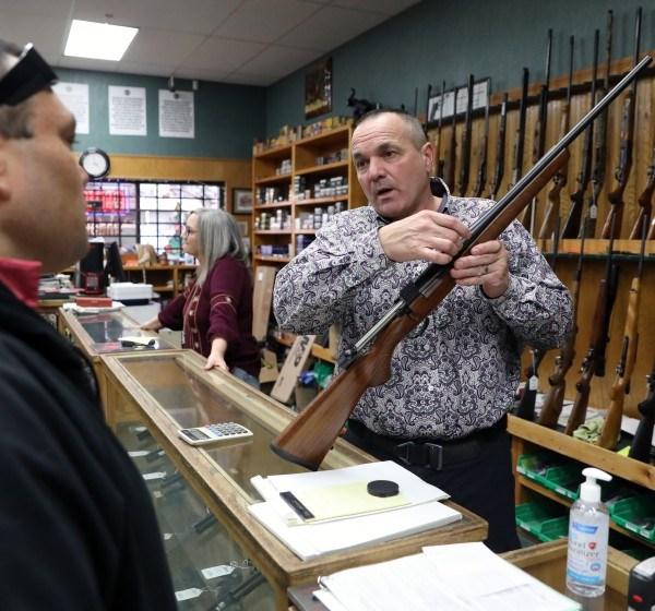 Shasta County Supervisor Patrick Jones is seen in his gun shop in Redding in this undated photo. (Gary Coronado / Los Angeles Times)