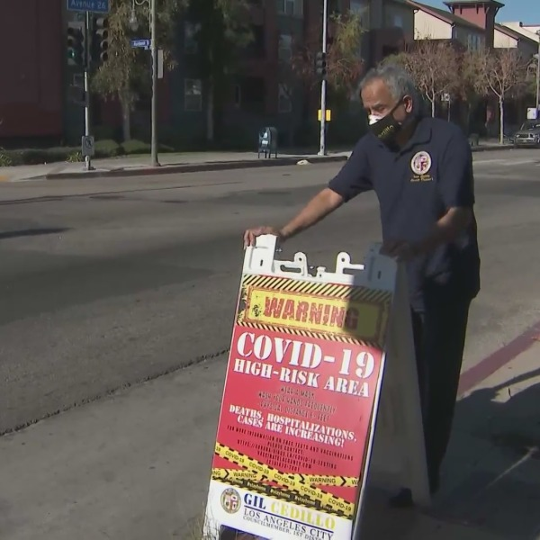 L.A. Councilman Gil Cedillo on Jan. 20, 2021 had these of warning signs placed in Westlake, Pico Union, Highland Park and Lincoln Heights. (KTLA)