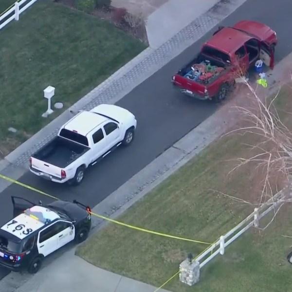 Authorities respond to investigate a shooting involving a sheriff's deputy in Santa Clarita on Jan. 11, 2021. (KTLA)