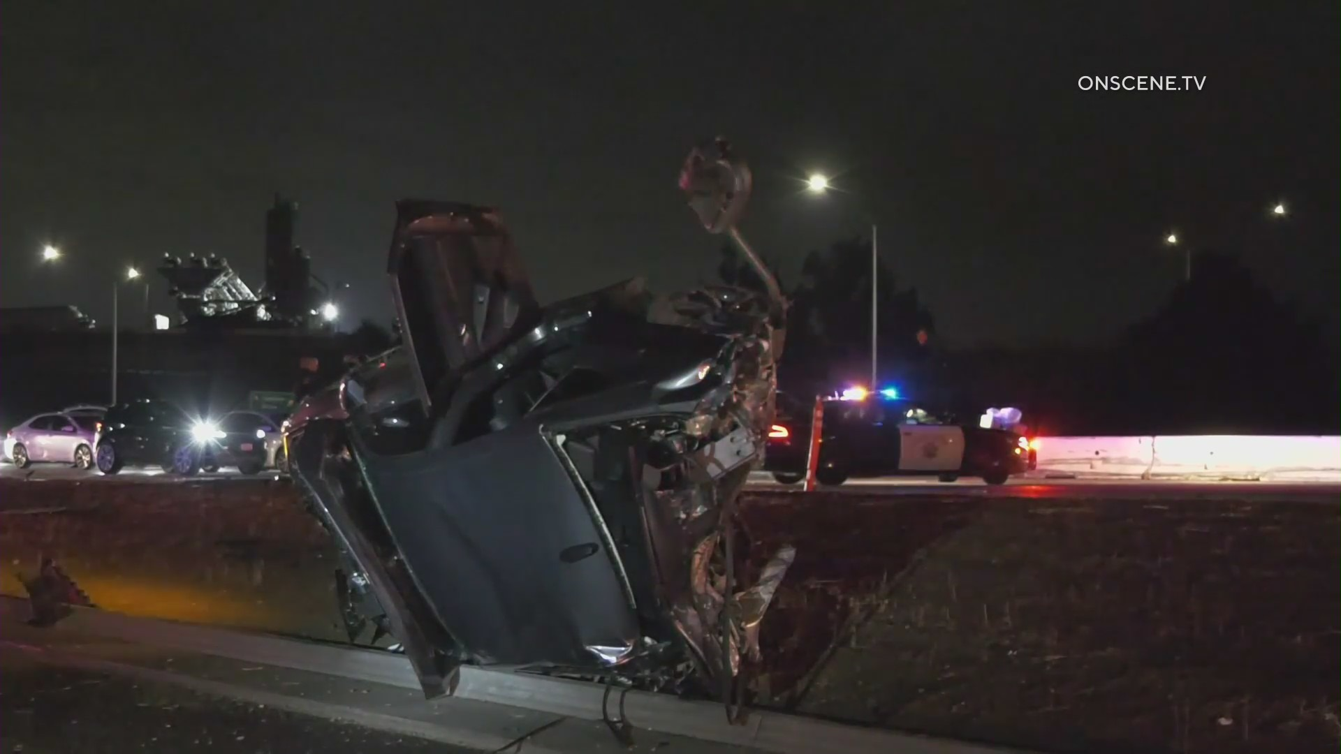 A severely damaged vehicle is seen after a deadly crash on the 10 Freeway in Pomona on Jan. 25, 2021. (Onscene.tv)