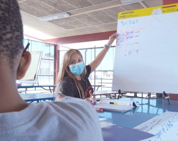 Fifth-grade teacher Maria Smith tutors a student at Eshelman Elementary in Lomita in the fall semester of 2020. (LAUSD via Los Angeles Times)