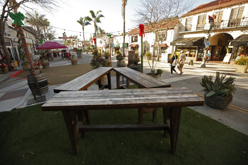 The COVID-19 death toll has doubled in Ventura County since Nov. 1, 2020. Above, few are out and about in downtown Ventura in December. (Al Seib / Los Angeles Times)