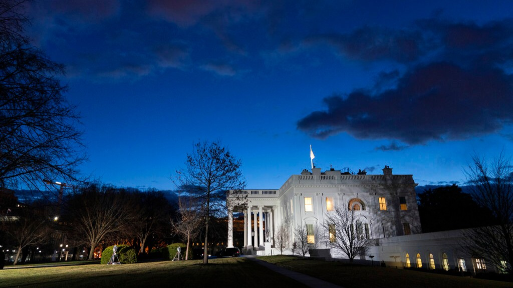 The sun rises behind the White House at dawn, Wednesday, Jan. 20, 2021, in Washington. (AP Photo/Alex Brandon)