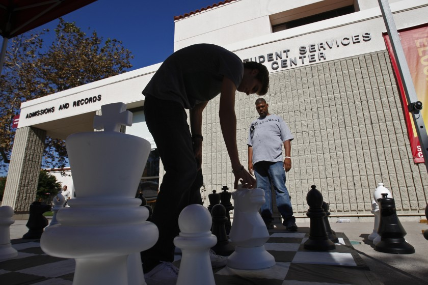 Saddleback Community College students play a game of chess on campus in an undated photo. (Allen J. Schaben / Los Angeles Times)