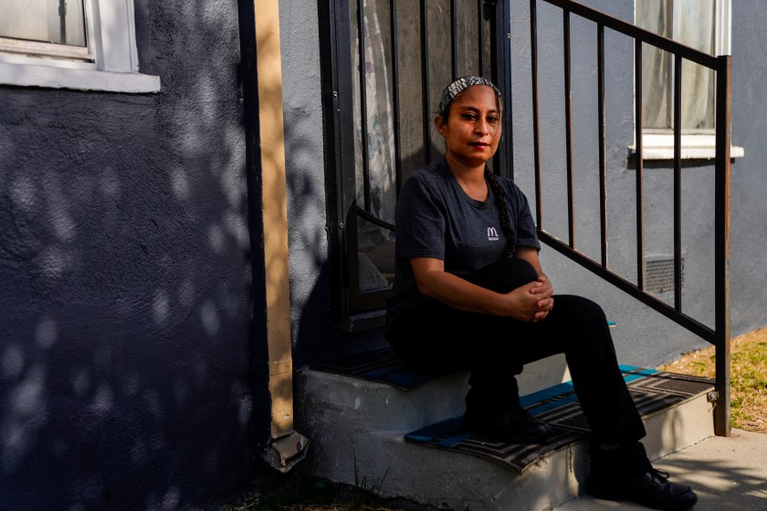 Lizzett Aguilar, 36, is seen in an undated photo outside her home in East Los Angeles. The California Labor Commissioner fined a McDonald's franchisee for firing Aguilar after she helped lead strikes to protest inadequate protections against the coronavirus. (Kent Nishimura/Los Angeles Times)
