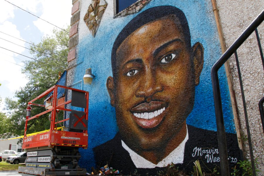 In this May 17, 2020, photo, a recently painted mural of Ahmaud Arbery is on display in Brunswick, Ga., where the 25-year-old man was shot and killed in February. It was painted by Miami artist Marvin Weeks. (AP Photo/Sarah Blake Morgan)
