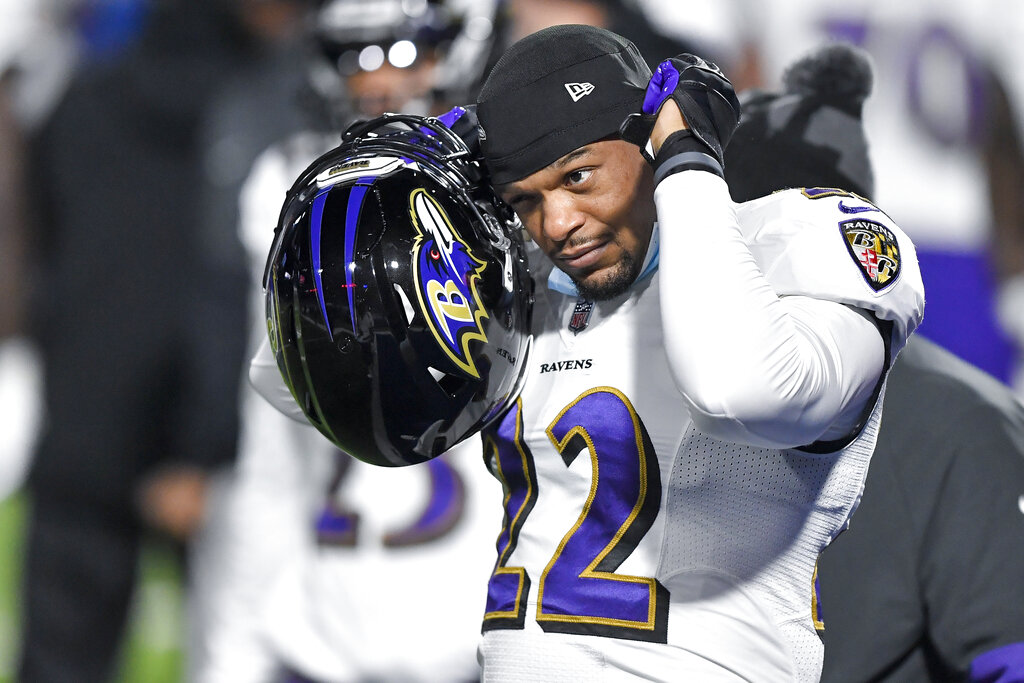 Baltimore Ravens cornerback Jimmy Smith (22) warms up before an NFL divisional round football game against the Buffalo Bills Saturday, Jan. 16, 2021, in Orchard Park, N.Y. (AP Photo/Adrian Kraus)