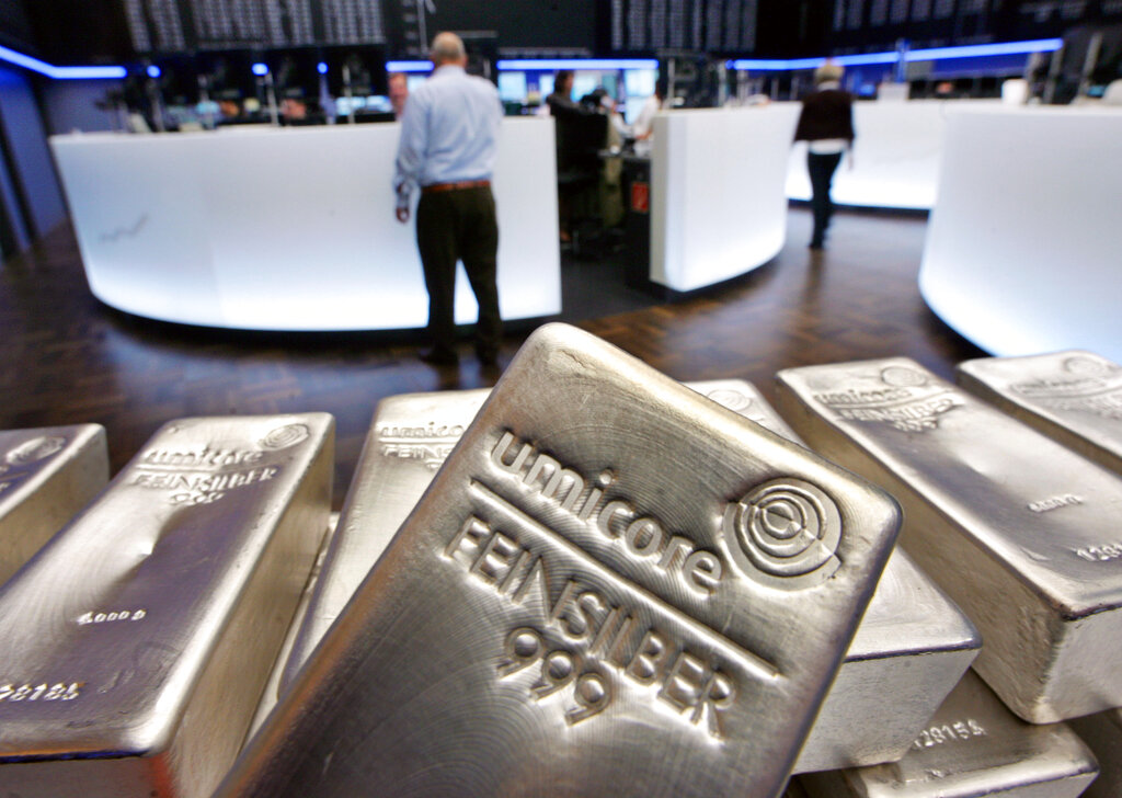 In this file photo dated Wednesday, May 9, 2007, Silver bullion, bars weighing five kilograms each, are displayed in the trading room of the stock exchange in Frankfurt, Germany. (AP Photo/Michael Probst, FILE)